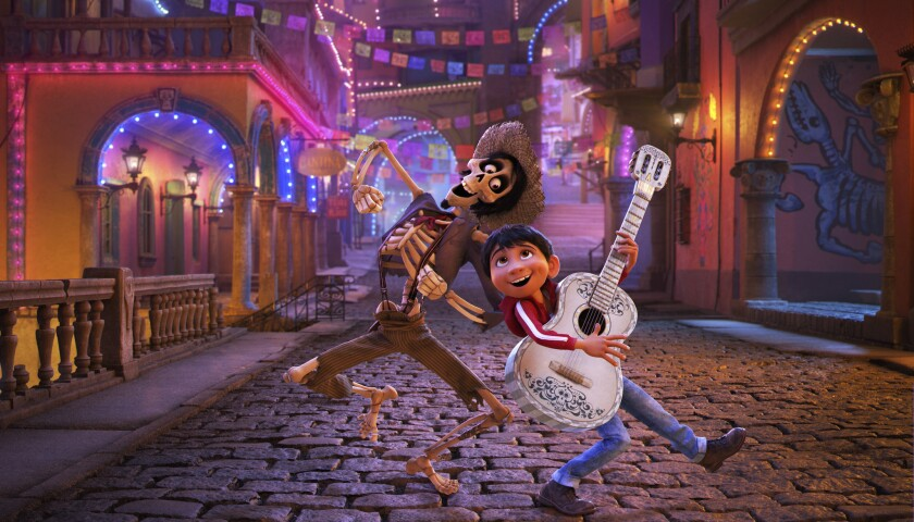 In this image released by Disney-Pixar, character Hector, voiced by Gael Garcia Bernal, left, and Mi