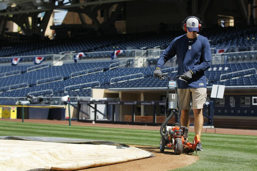 Luke Yoder is shown here trimming the infield grass at Petco Park.