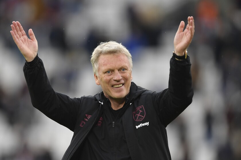 FILE - In this Sunday May 23, 2021 file photo, West Ham's manager David Moyes applauds at the end of their English Premier League soccer match against Southampton at the London stadium in London, England. West Ham has given manager David Moyes a three-year contract extension after a season in which he led the Premier League club to European qualification, it was announced Saturday, June 12. The resurgent Hammers achieved their highest Premier League points total in finishing sixth to earn a spot in next season's Europa League. (Justin Tallis/Pool via AP, file)