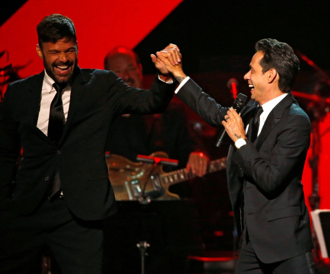 Recording artist Marc Anthony gives a high five to singer Ricky Martin after accepting the Latin Recording Academy Person of the Year award in Las Vegas, Nevada U.S., November 16, 2016. REUTERS/Mario Anzuoni ** Usable by SD ONLY **