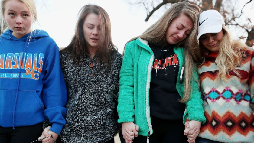 Students participate in a prayer vigil for the two people killed and 17 wounded in a mass shooting in Benton, Ky., on Jan. 23.