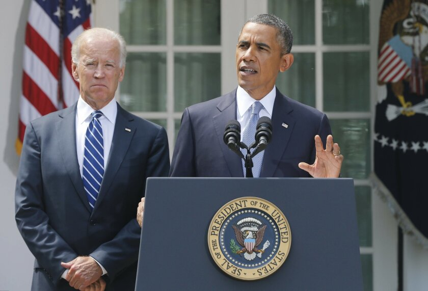 President Barack Obama stands with Vice President Joe Biden as he makes a statement about Syria in the Rose Garden at the White House in Washington, Saturday, Aug. 31, 2013. Obama said he has decided that the United States should take military action against Syria in response to a deadly chemical w