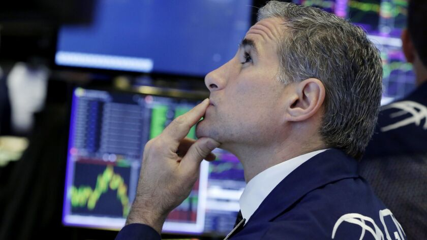 Specialist Anthony Rinaldi works at his post on the floor of the New York Stock Exchange.