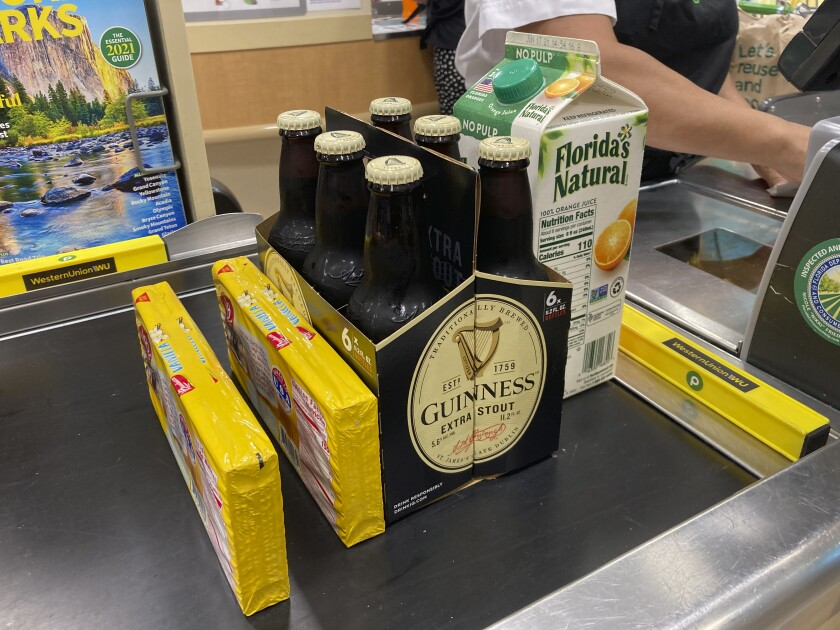 Groceries on a checkout counter at a grocery store