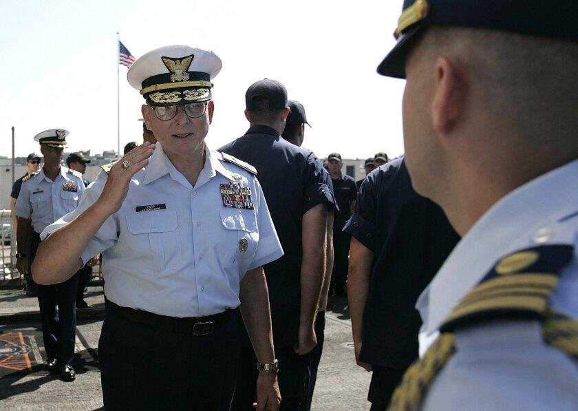 Adm. Robert Papp (left) met with Coast Guard crew members serving aboard the cutter Sherman.