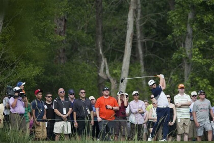Hunter Mahan tees off from the eleventh hole during the third round of the Houston Open golf tournament on Saturday, March 31, 2012, in Humble, Texas. (AP Photo/Eric Kayne)