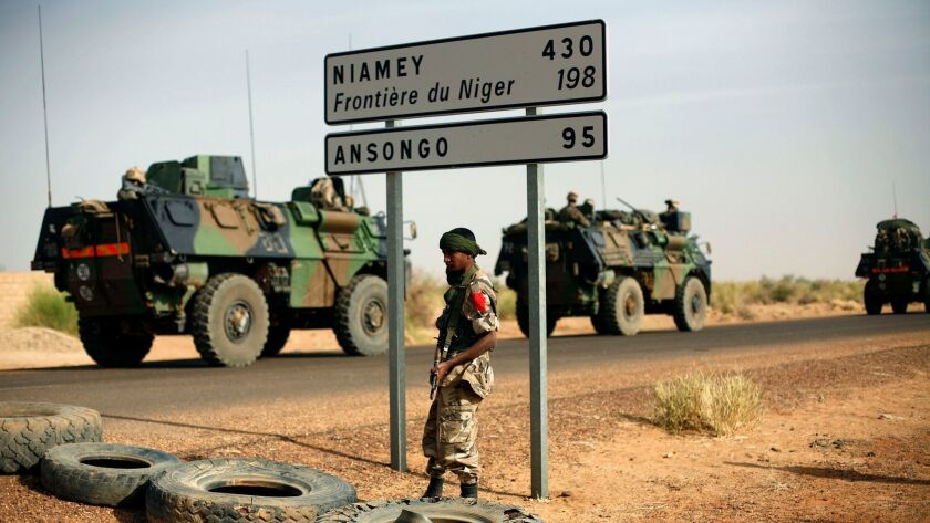 French armored vehicles head toward the Niger border in 2013. U.S. and French forces have spent years training and supporting the militaries of Mali, Niger and other countries to fight entrenched Islamic extremism.