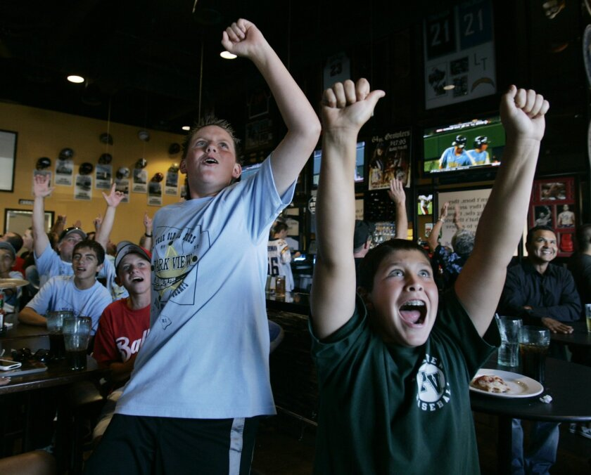 Bradley Snyder (left) and Marc Evan, both 11, were among those at Oggi's Pizza & Brewing Co. yesterday to cheer on the Chula Vista Park View All-Stars as they thumped a team from Kentucky 15-0 in a first-round game at the Little League World Series in South Williamsport, Pa.