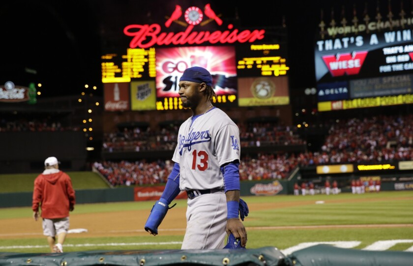 Shortstop Hanley Ramirez walks off the field after the Dodgers were eliminated from the postseason by the Cardinals in Game 4 of the National League Division Series on Monday in St. Louis.