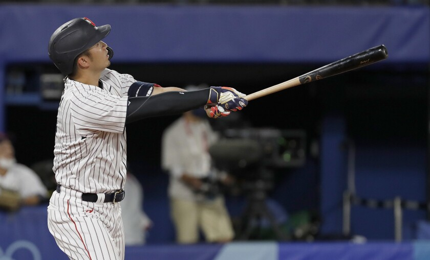 Japan's Selya Suzuki hits a home run during the fifth inning of a 7-6 victory over the United States.