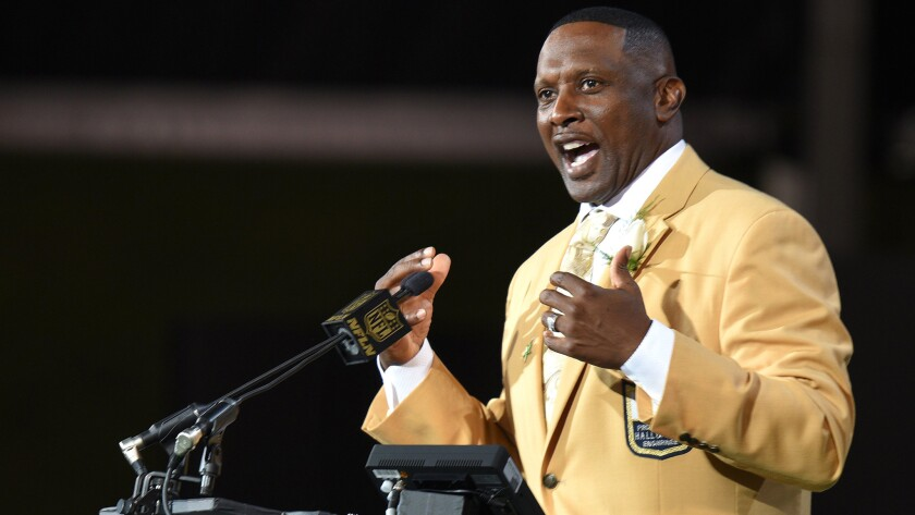 Tim Brown addresses the audience during his induction ceremony at the Pro Football Hall of Fame in 2