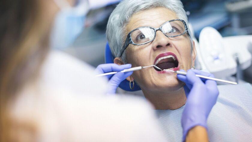Senior female patient at dentist office