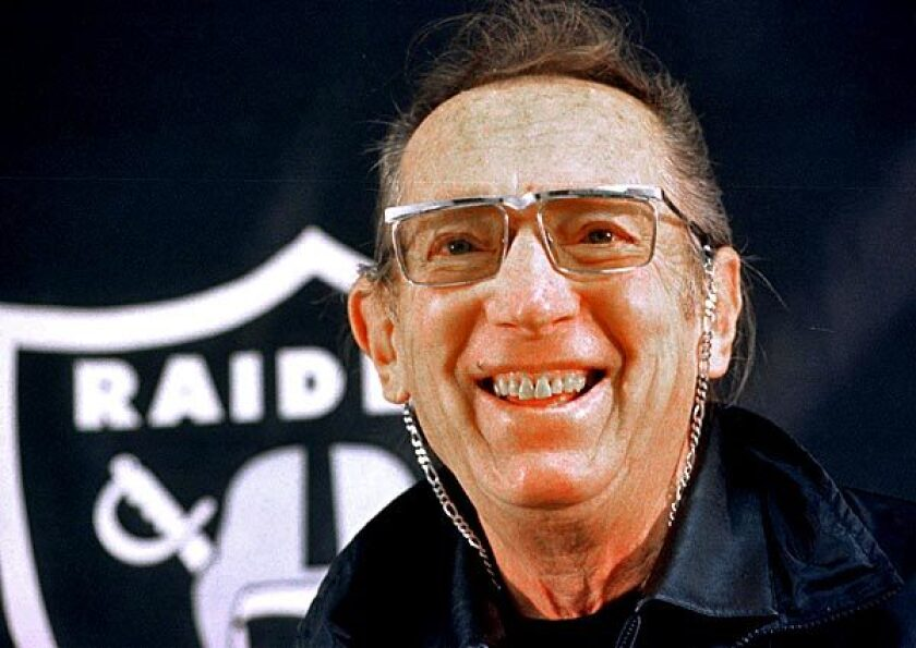 Oakland Raiders owner Al Davis speaks at a news conference in November 1996.