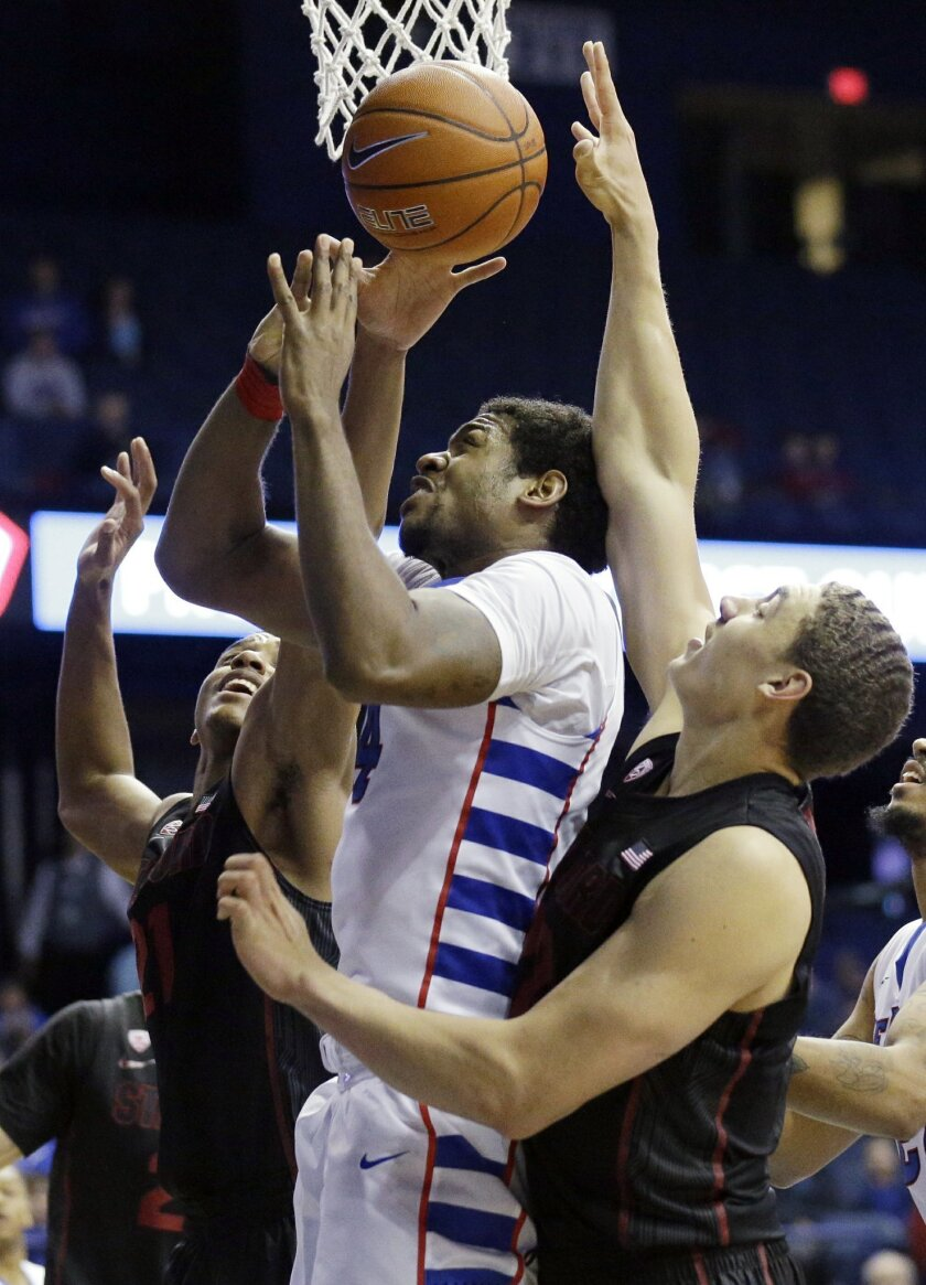 DePaul forward Myke Henry, center, goes up for a shot against Stanford guard/forward Anthony Brown left, and forward Reid Travis during the second half of an NCAA college basketball game on Saturday, Nov. 30, 2014, in Rosemont, Ill. DePaul won 87-72. (AP Photo/Nam Y. Huh)