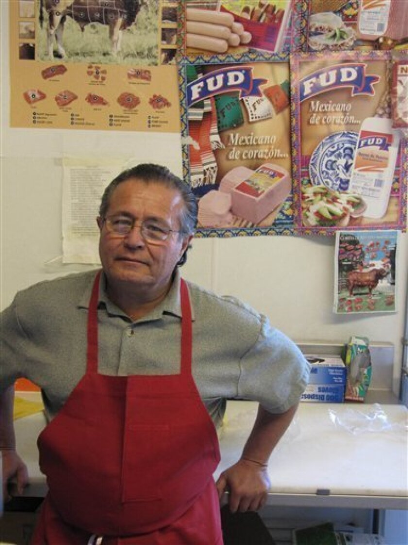 Jose Melendez, 55, poses for a photo Wednesday, April 14, 2010 at a meat shop in Flagstaff, Ariz. Melendez, a naturalized U.S. citizen, spoke out against a bill in the Arizona legislature that would create a new state misdemeanor crime of willful failure to complete or carry an alien registration d