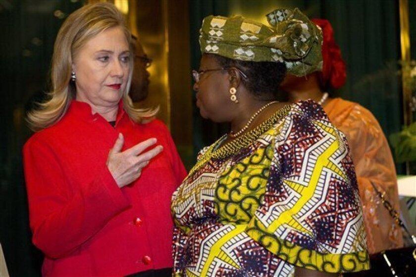 Secretary of State Hillary Rodham Clinton talks with Nigerian Finance Minister Ngozi Okonjo-Iweala, at the Presidential Villa in Abuja, Nigeria, Thursday, Aug. 9, 2012. (AP Photo/Jacquelyn Martin, Pool)