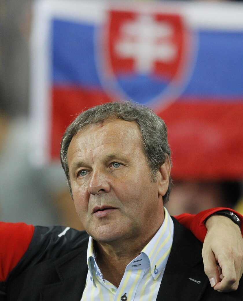 FILE - In this Monday, Sept. 8, 2014 file photo, Slovakia head coach Jan Kozak prior to the Euro 2016 group C qualifier soccer match between Ukraine and Slovakia at the Olympiyskiy national stadium in Kiev, Ukraine. (AP Photo/Sergei Chuzavkov, File)
