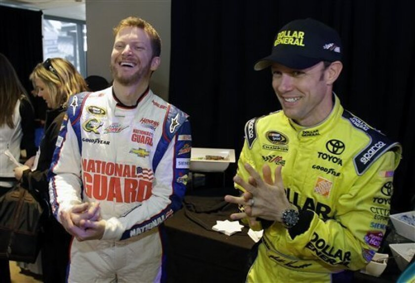 Dale Earnhardt Jr., left, and Matt Kenseth joke around during a break at NASCAR media day at Daytona International Speedway, Thursday, Feb. 14, 2013, in Daytona Beach, Fla. (AP Photo/John Raoux)