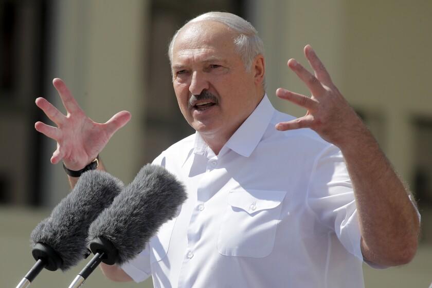 Belarusian President Alexander Lukashenko addresses supporters in Minsk on Sunday.