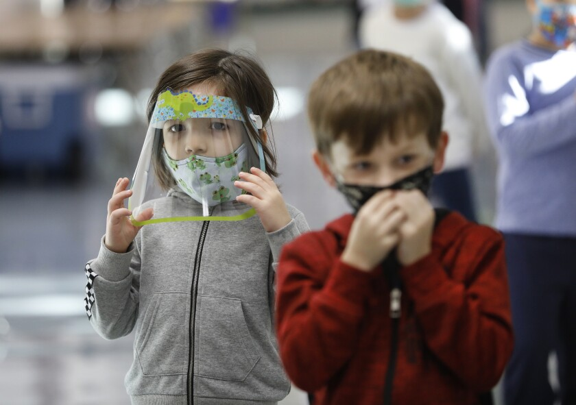 Kindergarten students of teacher Ursula Dysthe wear face protection at Lupin Hill Elementary School in Calabasas.
