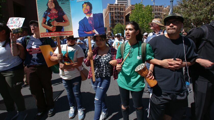 A group marched from City College down Broadway to Front Street for May Day rally to stage a peaceful rally in front of the Federal Building in downtown.