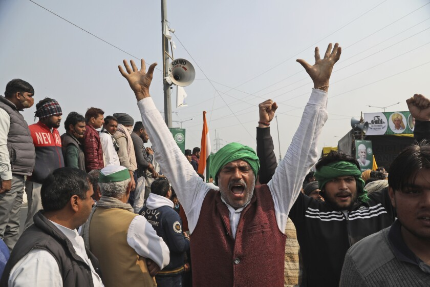 Farmers protest agriculture laws on the outskirts of New Delhi.