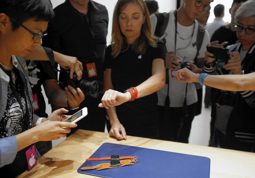 People try out new Apple Watch bands after the company's announcement of new products during an event at the Bill Graham Civic Auditorium in San Francisco.
