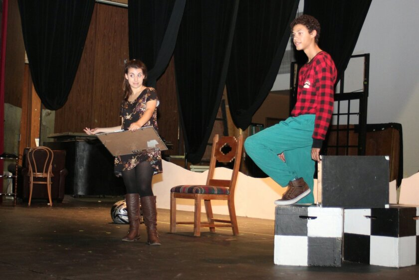 Emma Wineman and Tanner Perry receive direction from Treger, during rehearsals for 'Almost, Maine.' Perry has appeared in each of La Jolla High's theatrical productions since freshman year. 'Almost, Maine' will be Wineman's first show.