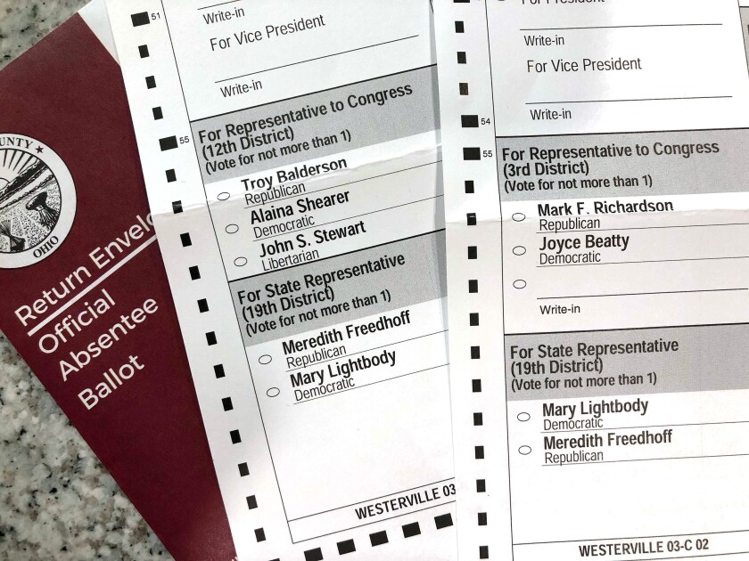 This photo made on Oct. 6, 2020, in Westerville, Ohio, shows Ohio absentee ballots. Two voters registered at the same address in the Columbus suburb of Westerville, Ohio, were mailed these differing absentee ballots for the 2020 general election, with one of the ballots listing candidates from a different congressional district. (AP Photo/Kantele Franko)