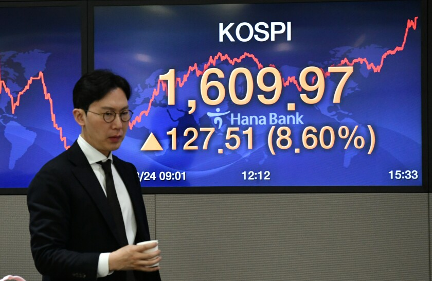 A currency dealer at KEB Hana Bank's trading room in  Seoul on March 25.