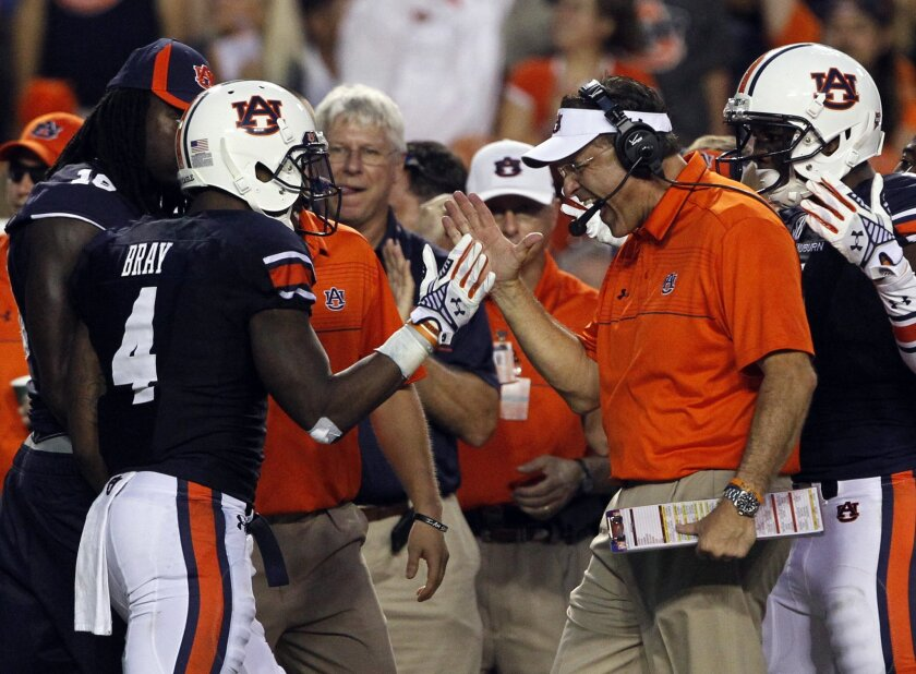 Auburn head coach Gus Malzahn celebrates with wide receiver Quan Bray (4) after he returned a punt for a touchdown during the first half of an NCAA college football game against San Jose State on Saturday, Sept. 6, 2014, in Auburn, Ala. (AP Photo/Butch Dill)
