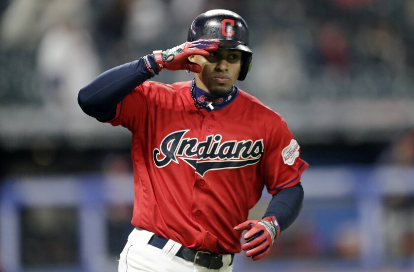 Cleveland Indians' Francisco Lindor salutes after hitting a solo home run off Atlanta Braves starting pitcher Max Fried in the seventh inning of a baseball game, Sunday, April 21, 2019, in Cleveland.