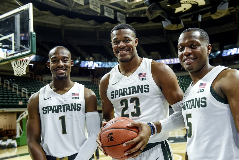 Joshua Langford, left, Xavier Tillman and Cassius Winston of Michigan State