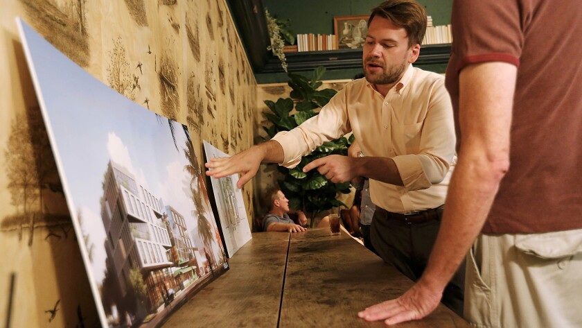 Jake Stevens tells local residents what the new property will look like at a meet and greet in West Hollywood.