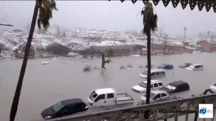 A handout grab image made from a video released on Sept. 6, 2017 by RCI Guadeloupe shows flooded str