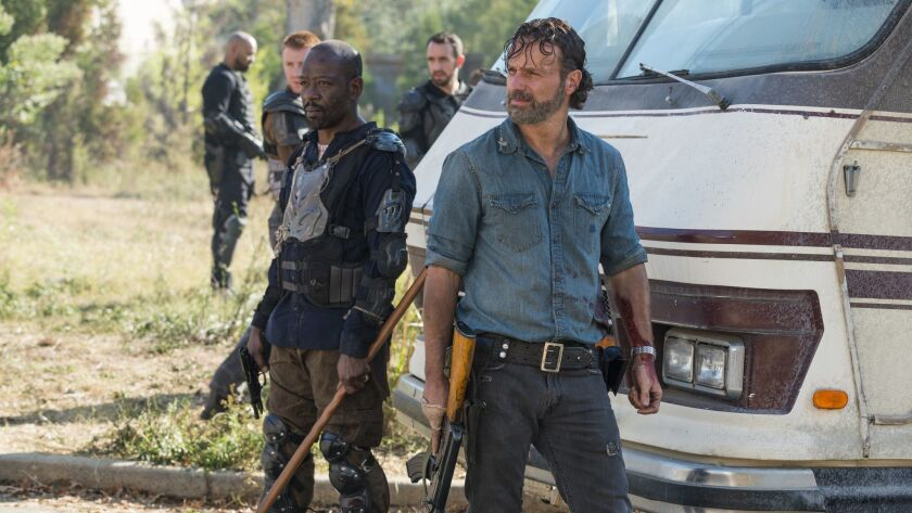 In this image released by AMC, Lennie James portrays Morgan Jones, left, and Andrew Lincoln portrays