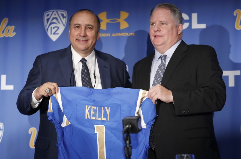 UCLA athletic director Dan Guerrero, left, hired football coach Chip Kelly on a five-year, $23.9-million contract in 2017.