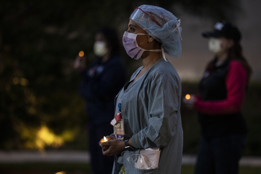 Union healthcare workers stage candlelight vigil at UC Irvine Medical Center