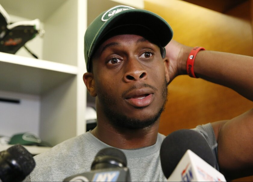 New York Jets quarterback Geno Smith speaks to reporters in front of his locker at the team's NFL football training facility, Wednesday, May 25, 2016, in Florham Park, N.J. (AP Photo/Kathy Willens