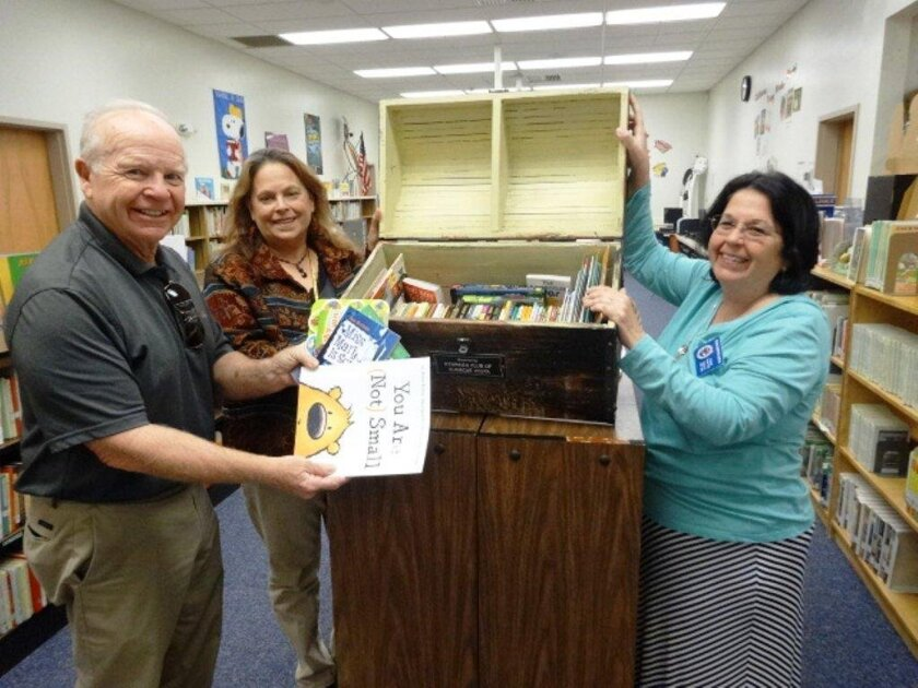 The Kiwanis Club of Sunrise Vista has put 6,000 books in several Vista schools since 2003 in the Treasure Chest of Books program. Students are rewarded for outstanding performance with a book they can choose from the Treasure Chest and take it home. From left: Pete McHugh, Treasure Chest of Books c