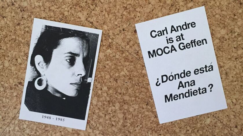 Protesters handed out postcards to honor the memory of the late Ana Mendieta at the opening of the C