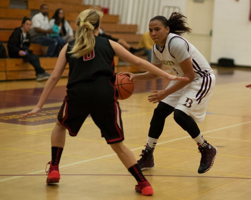 Destiny Littleton (right) of Bishop's attacks versus La Jolla's Amanda Polcyn in the third quarter Jan. 11. Littleton played big, physical and fast. Ed Piper