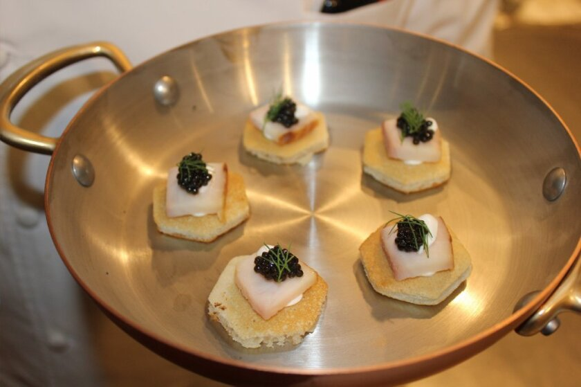Smoked sturgeon, caviar and blini appetizers prepared by the restaurant's staff.