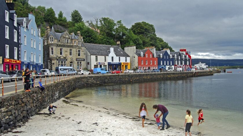 United Kingdom - Tobermory Beach with its arcing promenade and vividly and variously colored buildin