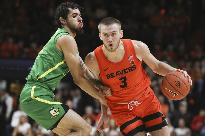 Oregon's Addison Patterson, left, defends against Oregon State's Tres Tinkle (3) during the first half of an NCAA college basketball game in Corvallis, Ore., Saturday, Feb. 8, 2020. (AP Photo/Amanda Loman)