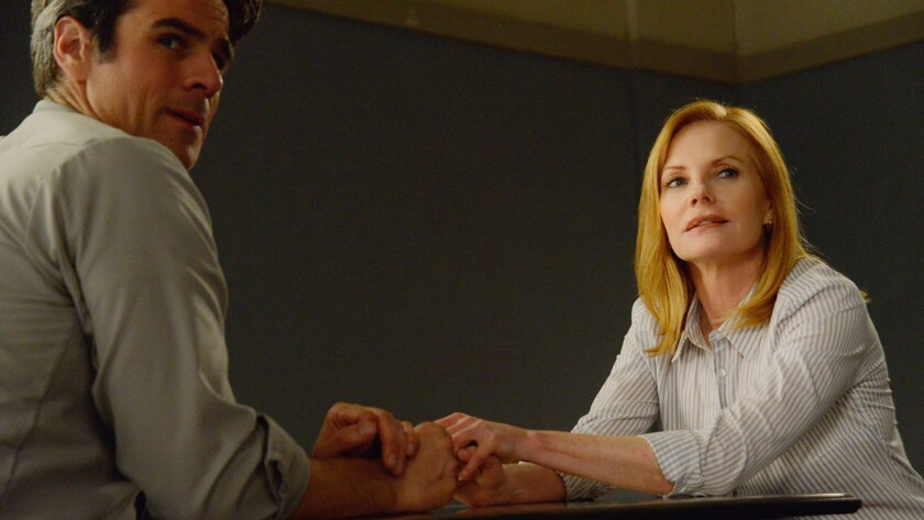 "Eddie Cahill and Marg Helgenberger in ""Under the Dome"" on CBS."