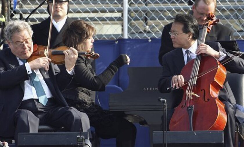 Violinist Itzahk Perlman, left, and cellist Yo-Yo Ma perform during the swearing-in ceremony at the U.S. Capitol in Washington, Tuesday, Jan. 20, 2009.  (AP Photo/Ron Edmonds)
