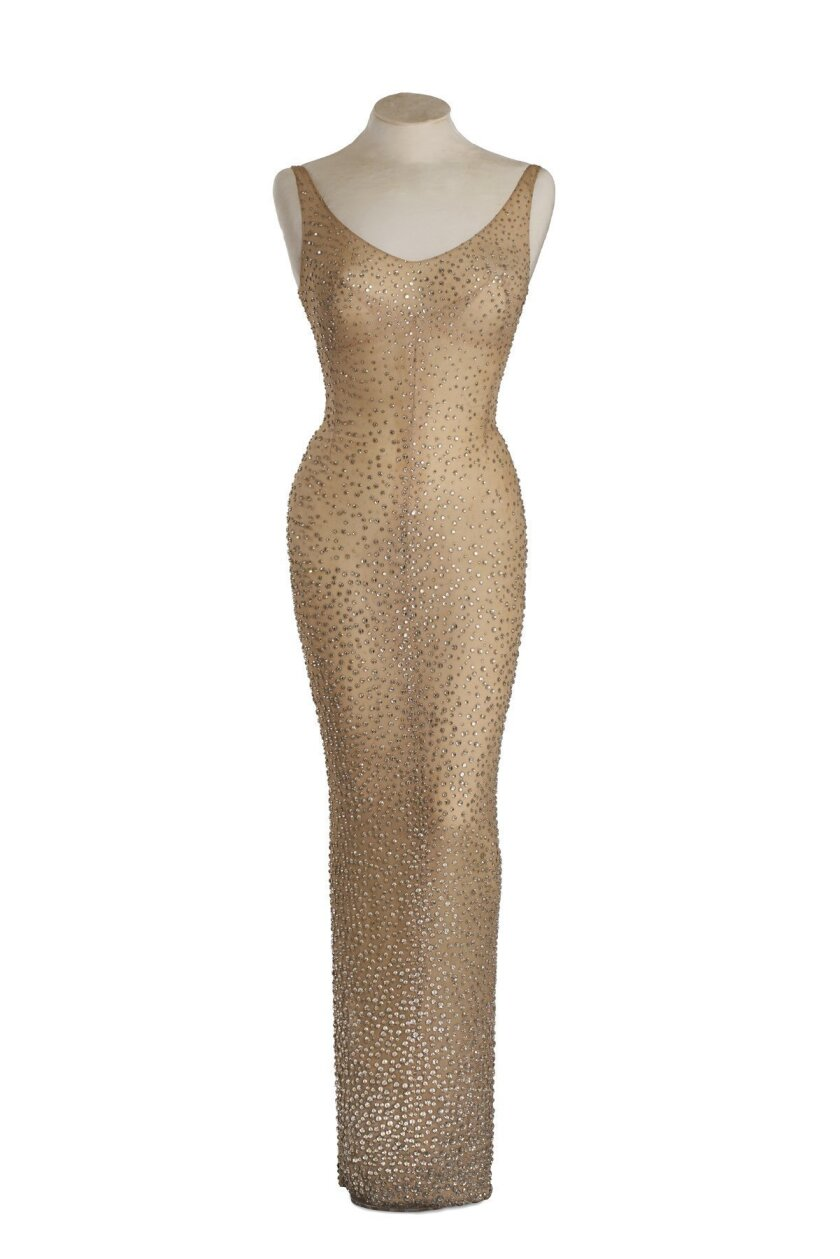"""This undated photo provided by Julien's Auctions shows the flesh-colored dress Marilyn Monroe wore during her rendition of """"Happy Birthday"""" to President John F. Kennedy. Julien's Auctions is offering the sequined stunner in Los Angeles on Nov. 17, 2016. (Julien's Auctions via AP)"""