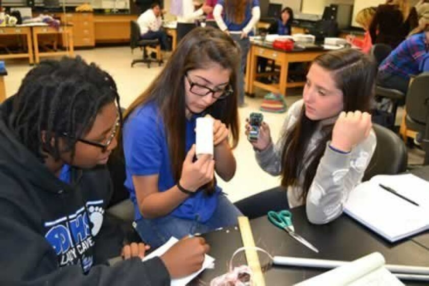 Students in the BE WiSE program develop their experiment, which will soon make its way to the International Space Station. Courtesy