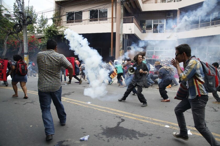 Protesters clash with police in Honduras
